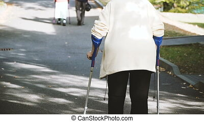 Elderly people. Elderly people with a cane in their hands