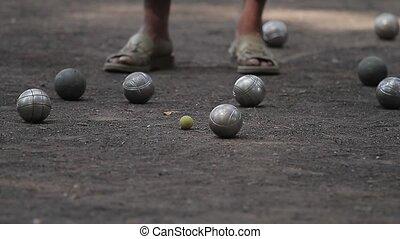 elderly people enjoying boule in a park