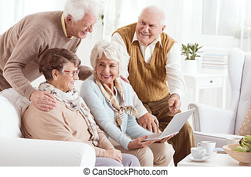 Elderly people enjoying modern technology
