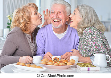 Elderly people having breakfast