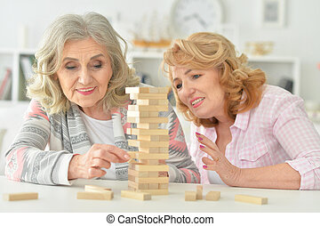 Elderly people playing a board game