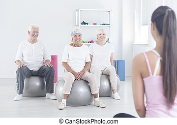 Elderly people sitting on balls