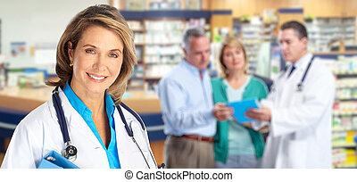 Elderly pharmacist doctor woman.