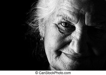 elderly - Portrait of a happy senior woman smiling at the...