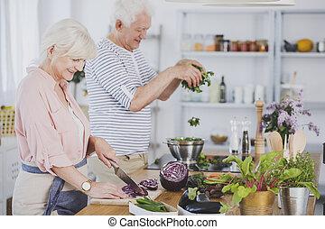 Elderly preparing healthy meal together