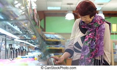Elderly pretty woman shopping for fresh healthy food in the supermarket.