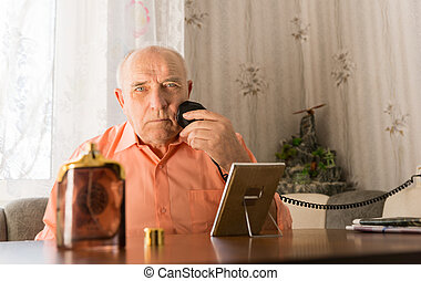 Elderly Shaving his Beard with Oil and Mirror