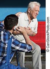 Elderly sick man is having chest pain
