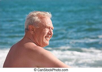 elderly smiling man on seacoast