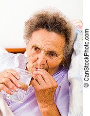 Elderly Taking Pills