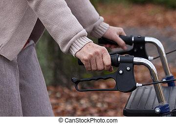 Elderly walking with walker