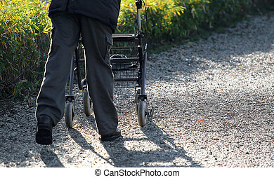 elderly with a Walker during the walk in the Park