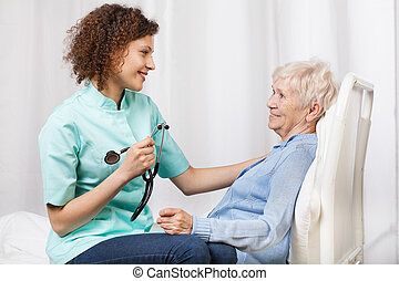 Elderly woman and her nurse