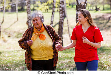 Elderly woman and young caregiver