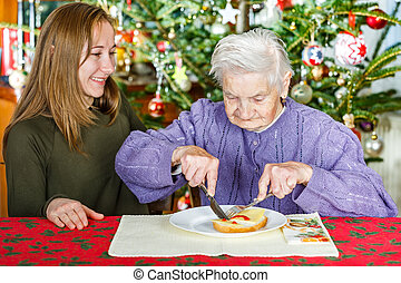 Elderly woman and young carer - Photo of elderly women with...