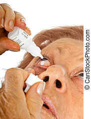 Elderly woman applying eye drops