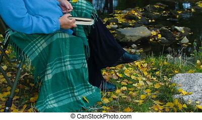 elderly woman at autumn park