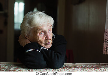 Elderly woman at home. Taking care of lonely old pensioners.