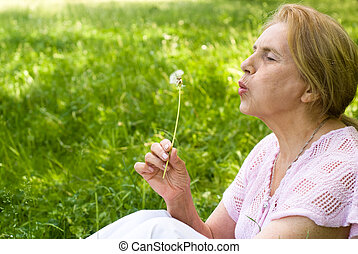 elderly woman at nature