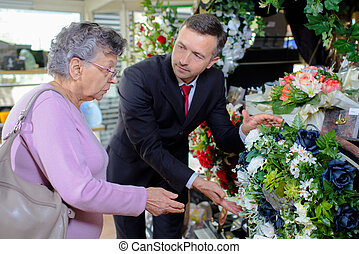 elderly woman choosing a bouquet