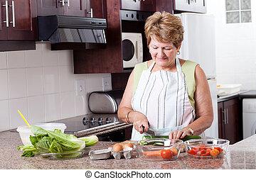 elderly woman cooking food