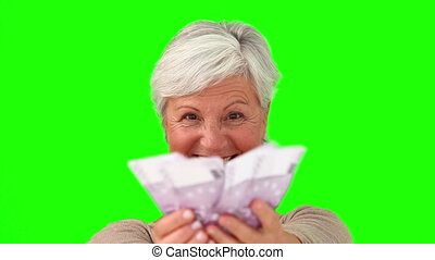 Elderly woman counting her cash
