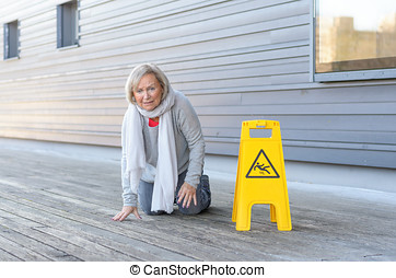 Elderly woman crawling on her knees after slipping - Elderly...