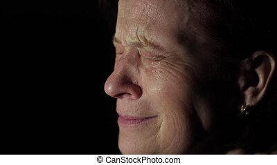 Elderly woman crying - Aged woman crying at dark room