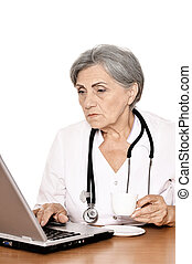Elderly woman doctor working with a laptop