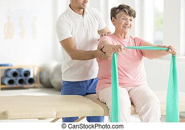 Elderly woman doing exercises