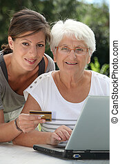 Elderly woman doing shopping on internet