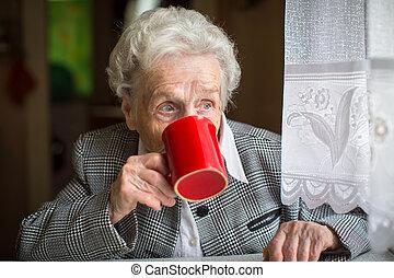 Elderly woman drinking