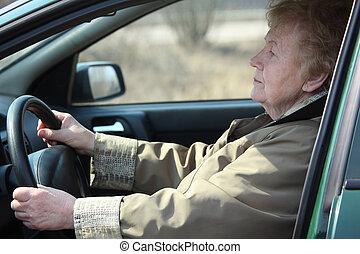 Elderly woman-driver in car