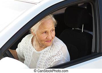 Elderly woman driving car.