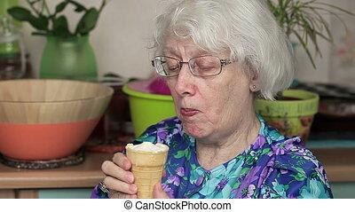 Elderly woman eating ice cream