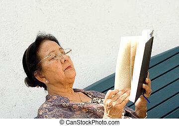 elderly woman enjoy read book