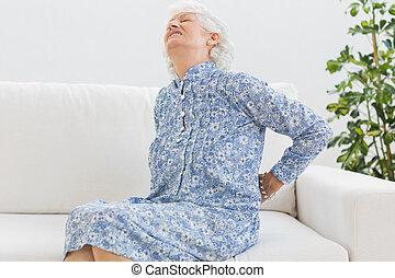 Elderly woman feeling back pain