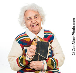 elderly woman flipping an old book