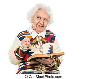 elderly woman flipping an old book