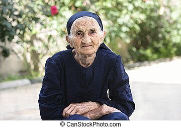 Elderly woman hands folded