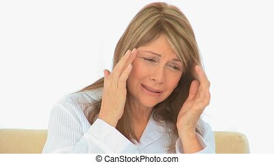 Elderly woman having a headache