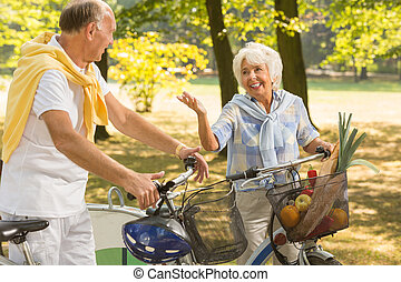 Elderly woman having bike trip