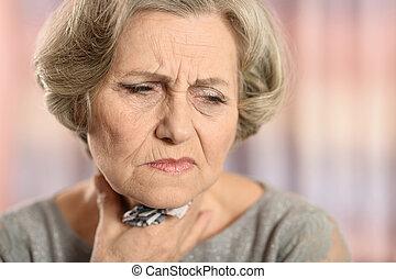 Elderly woman having soar throat on colored background