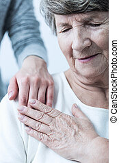 Elderly woman having support