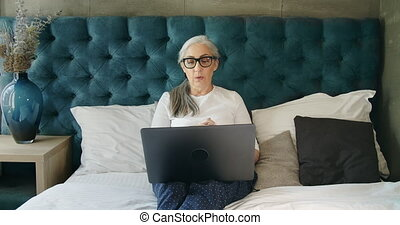 Elderly Woman Having Video Chat Laptop
