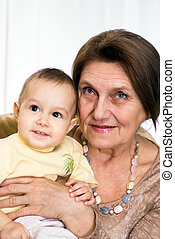 elderly woman holding a newborn