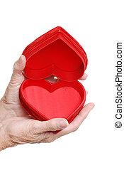 elderly woman holding heart box