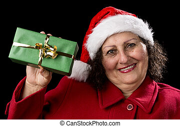 Elderly Woman Holding up a Green Wrapped Xmas Gift