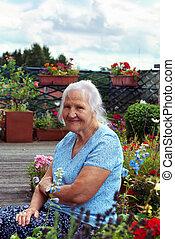 Elderly woman in garden