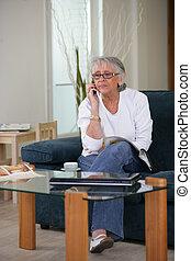 Elderly woman in her living room